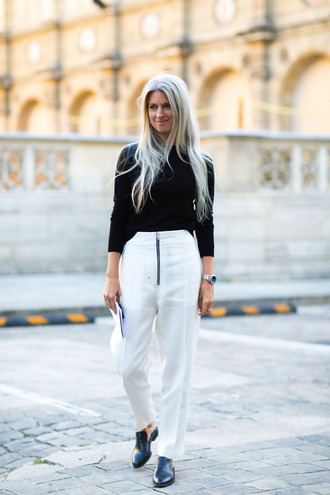 pants fashion week street style fashion week 2016 fashion week paris fashion week 2016 white pants high waisted pants top black top long sleeves flats black shoes black flats streetstyle