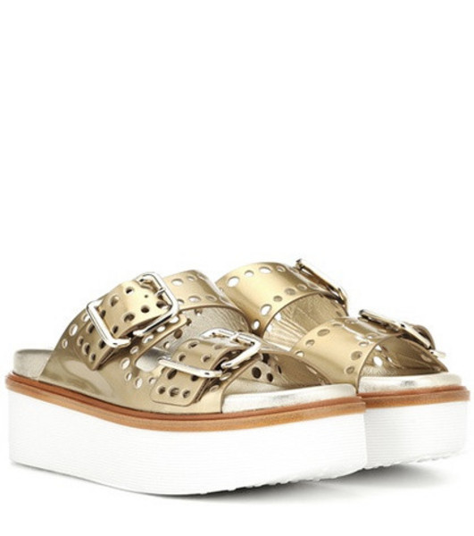 Tod's Perforated leather platform slides in gold