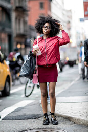 skirt,jacket,red,streetstyle,ny fashion week 2017,fashion week 2017,nyfw 2017,fashion week,pink jacket,bomber jacket,pink bomber jacket,dress,mini dress,pink dress,boots,black boots,ankle boots,socks,bag,pink bag,curly hair