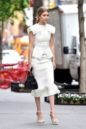 skirt,Celebrity work outfits,work outfits,office outfits,white skirt,peplum skirt,midi skirt,peplum top,peplum,white top,bag,black bag,sandals,sandal heels,high heel sandals,white sandals,gigi hadid,celebrity style,celebrity,model,model off-duty