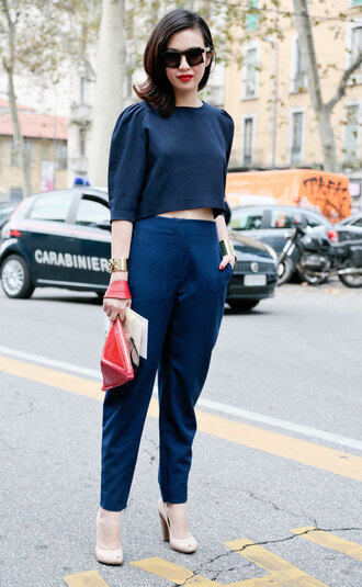 top all navy blue outfit all blue outfit crop tops blue top pants blue pants office pants bag red bag pumps nude pumps sunglasses black sunglasses cuff bracelet bracelets