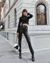 pants,black pants,leather pants,boots,ankle boots,shoulder bag,belt,crop tops,black blouse,chain necklace