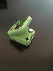 home accessory,green,lighter,box