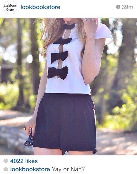 white top dress black bows black skirt gold jewels black clutch