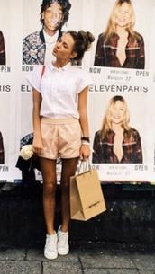beige shorts,white shirt
