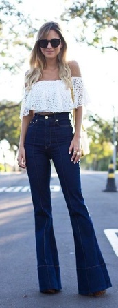 jeans,top,white crop tops,off shoulder crop top,white off shoulder top,lace crop top,white lace crop top,lace off shoulder crop top,high waisted bell bottom jeans,high waisted jeans,bell bottom jeans,oversized sunglasses,crossbody bag,70s style,streetstyle