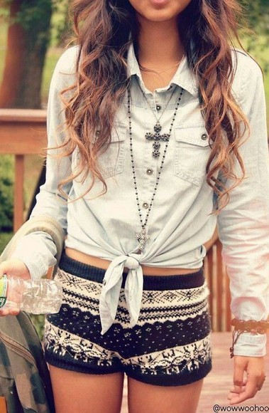 cross necklace blouse denim jeans cross necklace curly hair faded denim shirt button up button up blouse button up shirt tribal pattern short shorts mini shorts brunette patio grey pale blue baby blue dress shirt tied shirt long sleeve women teen girl teen girl model
