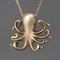 Long baby octopus necklace in brass with rubies