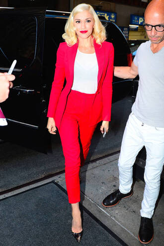 jacket pants suit gwen stefani fashion week 2014 red suit power suit womens suit cropped pants high waisted pants celebrity style celebrity blazer red blazer top white top pumps pointed toe pumps shoes red red lipstick high heel pumps two piece pantsuits matching set celebrity work outfits