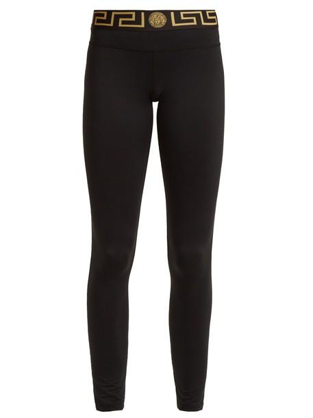 VERSACE leggings print gold black pants