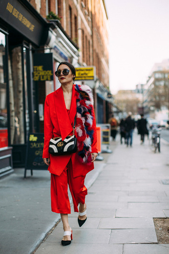 pants london fashion week 2017 fashion week 2017 fashion week streetstyle red pants culottes cropped pants blazer red blazer power suit matching set high heels heels bag printed bag gucci gucci bag scarf fur scarf sunglasses black sunglasses