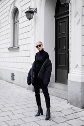 blogger,winter outfits,down jacket,boots,black pants,all black everything,turtleneck,cropped pants,victoria tornegren