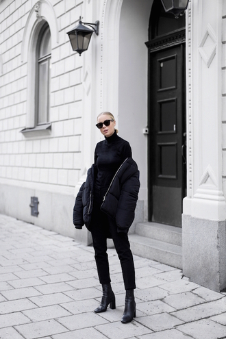 blogger winter outfits down jacket boots black pants all black everything turtleneck cropped pants victoria tornegren