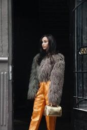 caradisclothed,blogger,jacket,pants,bag,faux fur jacket,handbag,orange pants,grey fur jacket,yellow,gold,gold bag,metallic,metallic bag