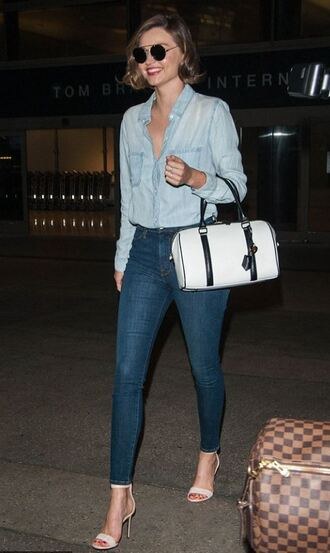 denim denim shirt model off-duty purse sandals skinny jeans spring spring outfits miranda kerr shirt