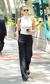 top,Celebrity work outfits,sleeveless,sleeveless top,office outfits,work outfits,turtleneck,pants,wide-leg pants,black pants,bag,black bag,shoulder bag,sunglasses,aviator sunglasses,flats,ballet flats,black flats,karlie kloss,celebrity style,celebrity,model,model off-duty,spring outfits