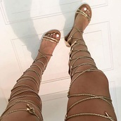 shoes,gold,knee high gladiator sandals,gladiators,lace up sandals,gladiator lace up sandals,thigh highs,thigh high sandlas,sandals,rope,gold rope,flat gladiator sandals,cute,tie,strappy,strappy sandals,knee high,lace up,long sandals,flat sandals,gold sandals,hercules,gold flat sandals,Gold low heel sandals,gold shoes,strappy heels,metallic,metallic shoes,flats