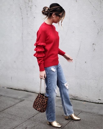 top red top ruffle ruffle sweater denim jeans blue jeans bag leopard print boots gold boots