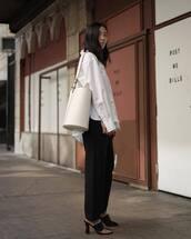 bag,shoulder bag,white bag,mules,black pants,wide-leg pants,white shirt,oversized shirt