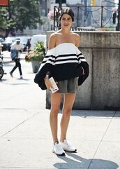 blouse,off the shoulder,stripes,off the shoulder top,white top,black and white,minimalist,parisian fashion,fashion week,man repeller,cold shoulder top,black and white top,striped top,clutch,white clutch,shorts,army green shorts,sneakers,white sneakers,leandra medina,stacked bracelets,bracelets,streetstyle,blogger,top,pants,urban,stylish,white cold shoulder,loose shirt,striped shirt,cold shoulder,grey shorts,streetwear,long sleeves