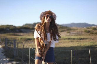 b a r t a b a c blogger off the shoulder top fringed bag denim skirt sun hat boho peasant top straw hat white off shoulder top white top top mini skirt blue skirt skirt brown bag round sunglasses