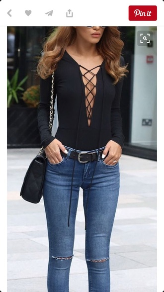 shirt black low cut shirt rosie huntington-whiteley top black body suit lace up detail lace up bodysuit blue jeans blue skinny jeans ripped jeans black pumps wayfarer black belt black leotard long sleeve bodysuit