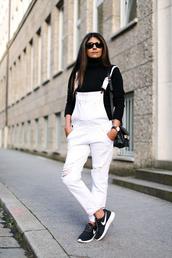 fashion landscape,blogger,jeans,bag,overalls,black turtleneck top,black top,turtleneck,sunglasses,black sunglasses,dungarees,denim overalls,sneakers,black sneakers,nike,nike shoes