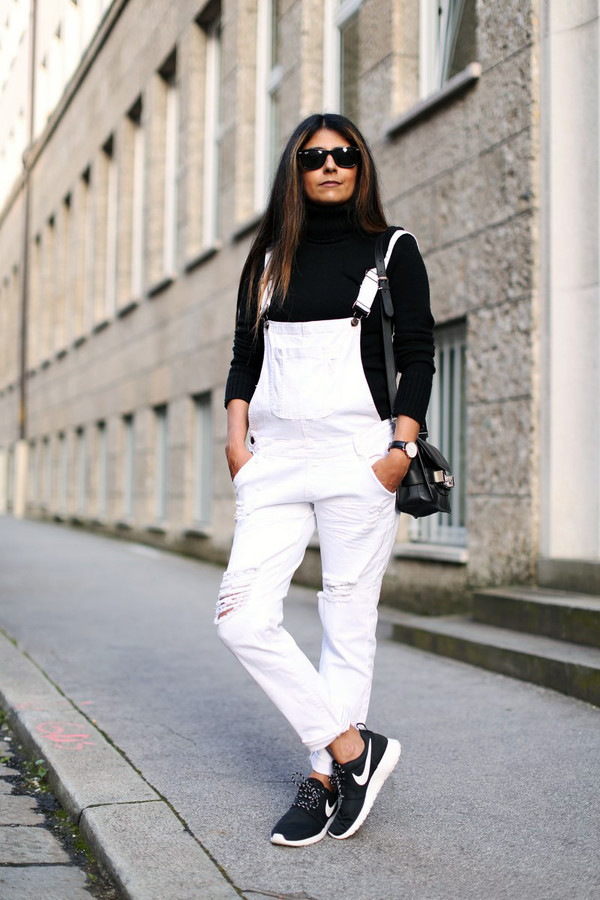 fashion landscape blogger jeans bag overalls black turtleneck top black top turtleneck sunglasses black sunglasses dungarees denim overalls sneakers black sneakers nike nike shoes