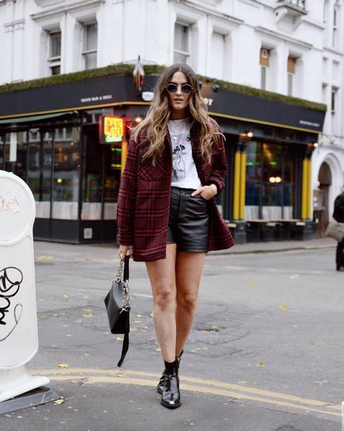 shorts black shorts leather shorts white t-shirt ankle boots black boots handbag coat checkered round sunglasses