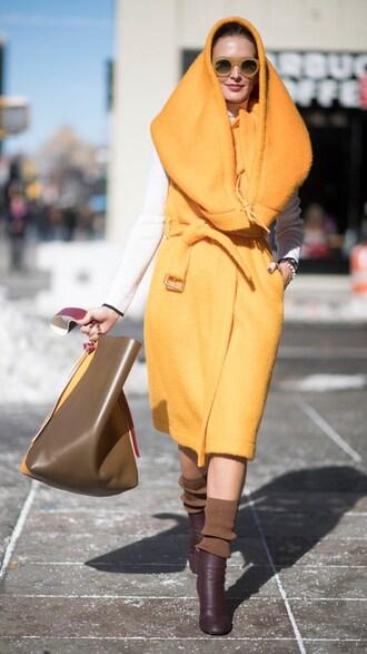 coat hood nyfw 2017 fashion week 2017 fashion week streetstyle orange orange coat socks boots brown boots ankle boots bag brown bag sunglasses sweater white sweater yellow sunglasses