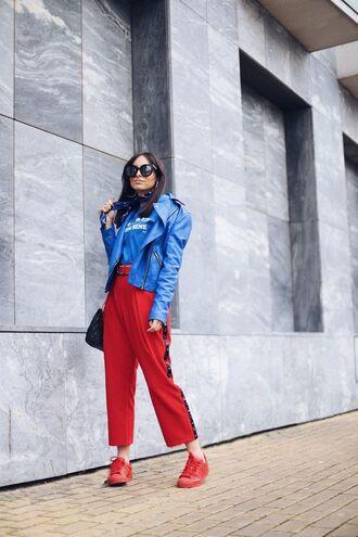 jacket blue jacket pants red pants red sneakers red adidas bag black bag micheal kors bag sunglasses silk scarf