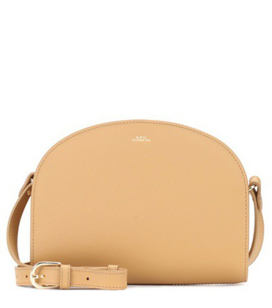A.P.C. Demi-Lune leather shoulder bag in beige / beige