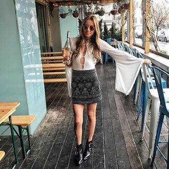 blouse bodysuit blogger white top long sleeves bell sleeves cut-out black skirt mini skirt embellished skirt round sunglasses pink sunglasses plunge v neck beaded