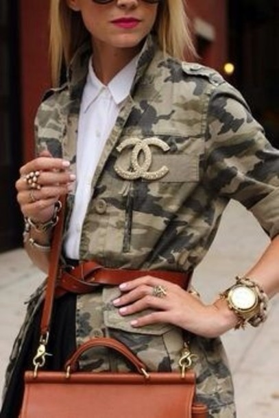 jewels brooch chanel brooch camouflage green coat army green jacket shirt white jacket white shirt bag brown bag belt watch