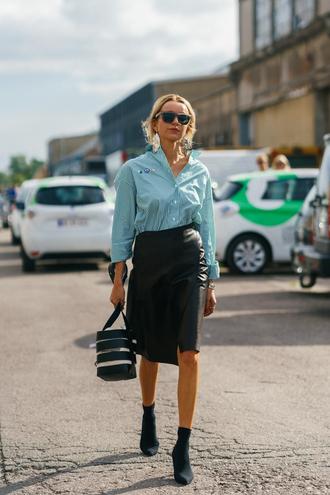 skirt copenhagen fashion week streetstyle midi skirt leather leather skirt wrap skirt boots black boots sock boots bag shirt blue shirt sunglasses