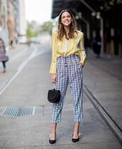 shoes,bag,pants,pumps,black pumps,shirt,yellow shirt