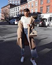 bag,white bag,blue jeans,coat,teddy bear coat,handbag,jeans,denim,sneakers,white sneakers,low top sneakers,white t-shirt,t-shirt