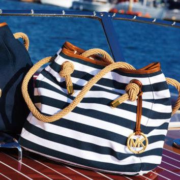 7afaeeac2848 Marina Large Canvas Grab Bag - Michael Kors on Wanelo