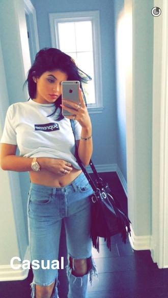 jeans kylie jenner high waisted jeans ripped jeans black bag t-shirt white t-shirt supreme top black and white shirt white bag