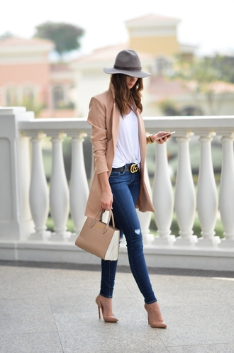 vogue haus blogger top jeans jacket bag shoes hat felt hat handbag high heel pumps pumps gucci belt beige coat winter outfits coat tumblr camel camel coat denim blue jeans skinny jeans pointed toe pumps nude heels t-shirt white t-shirt grey hat nude bag gucci logo belt