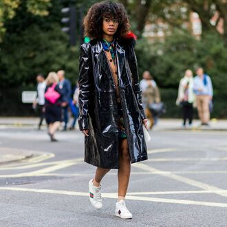 coat vinyl coat tumblr vinyl leather coat black leather coat sneakers gucci gucci sneaker low top sneakers white sneakers skirt mini skirt streetstyle curly hair glasses