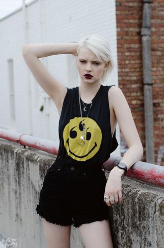 shirt sleeveless top black t-shirt yellow shirt black and yellow black and yellow top black and yellow shirt 666 smiley smiley face grunge top grunge t-shirt