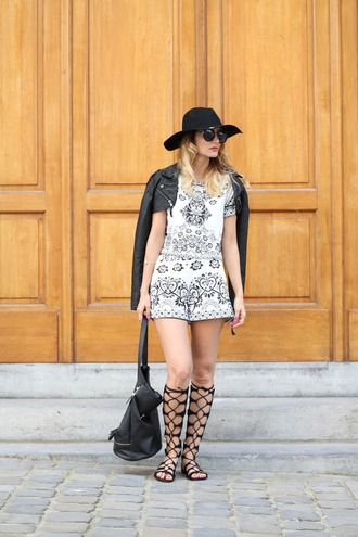 from brussels with love blogger shorts hat sunglasses bag shoes jewels black leather jacket black hat round sunglasses black bag lace up flats black and white white shorts white top