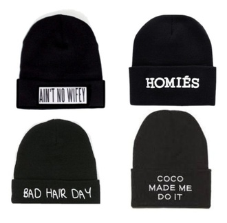 hat black woolen beanie with writing on front