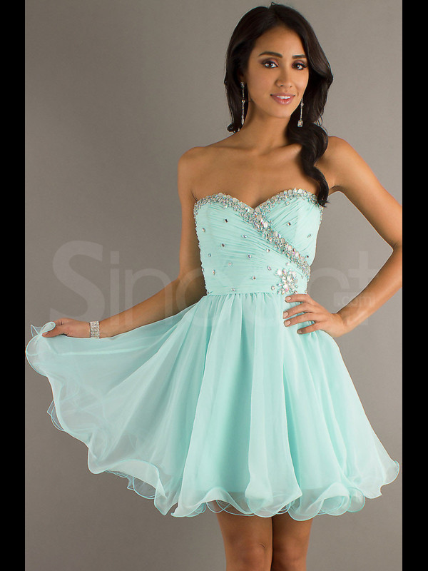 dress sleeveless and embelished with sqquins and beadings sweetheart and natural