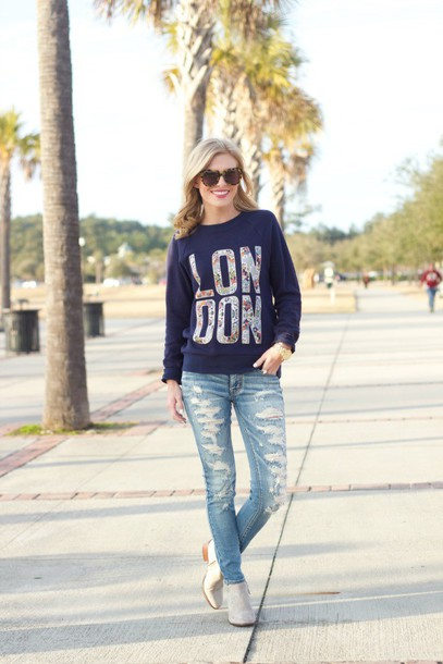 life with emily blogger london printed sweater ripped jeans sweater shoes sunglasses jewels sports sweater blue sweater blue jeans white boots