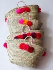 bag,pom poms,basket bag,basket tote,beach bag,straw bag,bridge basket bag,pink pompom,pompom bag,pompom basket bag,raffia bag,raffia,straw,tote bag