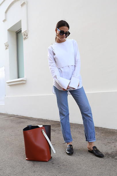 fashion vibe blogger shirt shoes bag jeans sunglasses asymmetric shirt white shirt blue jeans crop tops white top white crop tops brown bag black sunglasses gucci mules slide shoes black slides gucci princetown asymmetrical top