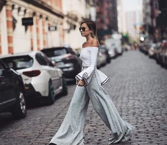 blouse off the shoulder streetstyle ny fashion week 2016 blogger instagram wide-leg pants jeans flare jeans long sleeves bell sleeves grey pants