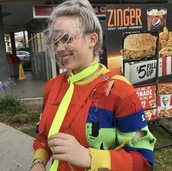 sweater,ripped,stripes,rainbow sweater,distressed sweater,tumblr,90s style,rainbow,striped sweater,billie,eilish,billie eilish,multicolor,holes,long sleeves